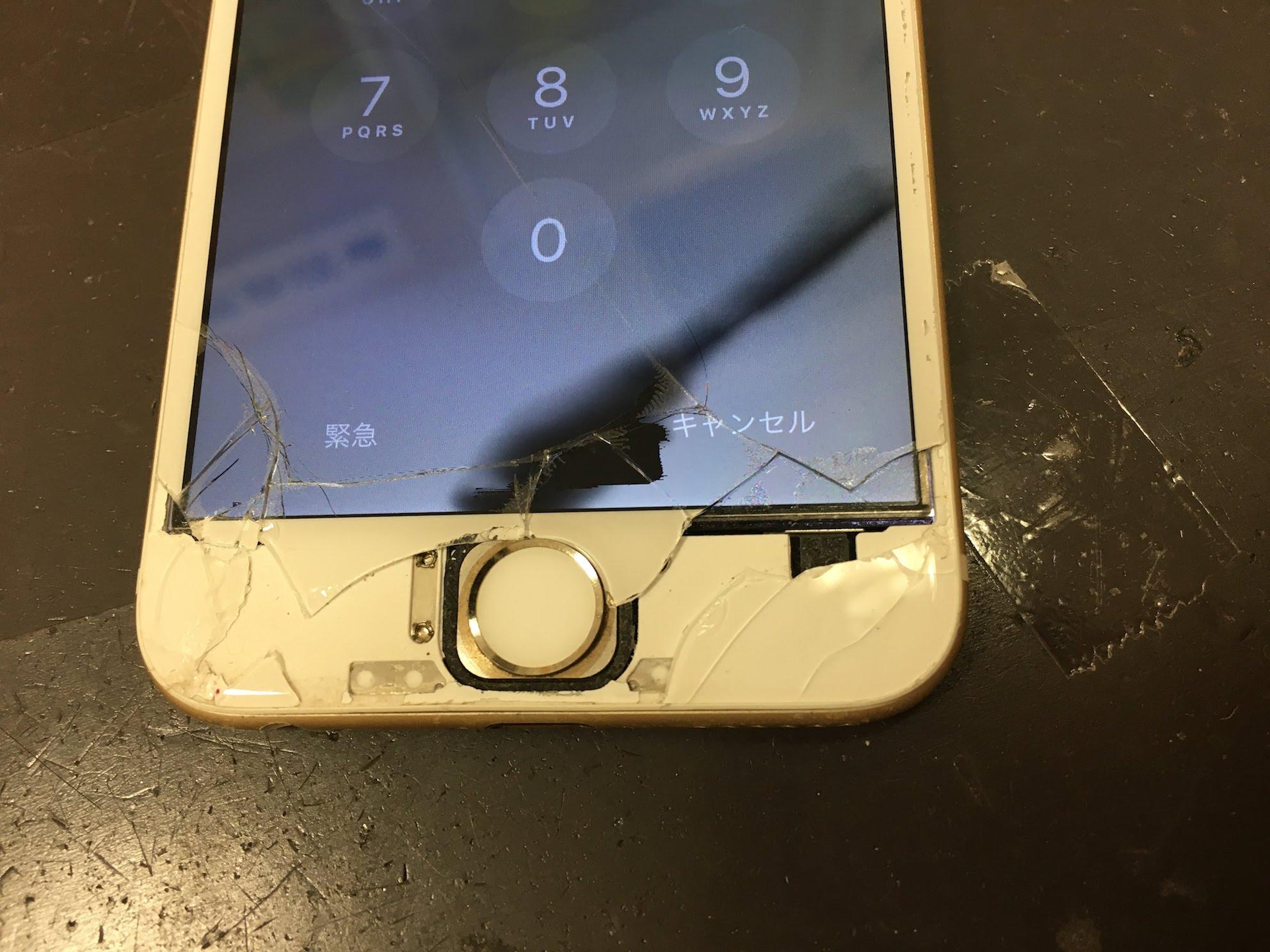 ガラスが割れてホームボタンが見えているiPhone6